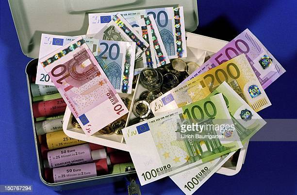 Cashbox with Euro banknotes and coins