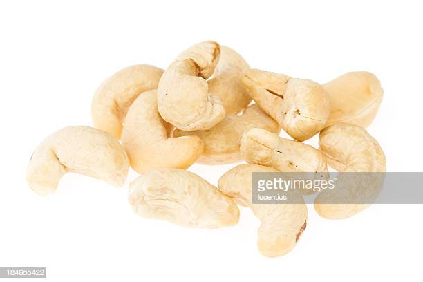 cashew nuts isolated on white - cashew stock pictures, royalty-free photos & images