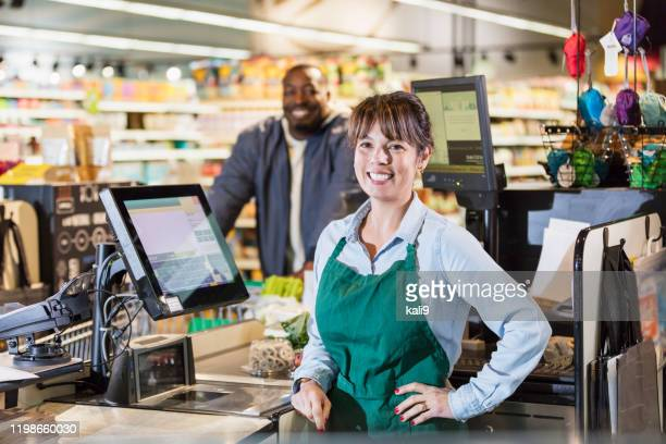 cashier at supermarket checkout lane - cashier stock pictures, royalty-free photos & images