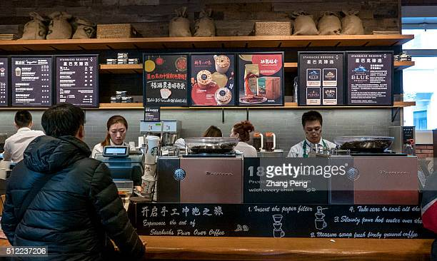 Cashier counter in a Starbucks coffee house Starbucks already has nearly 2000 stores in mainland China and plans to have 3400 by 2019 laying the...