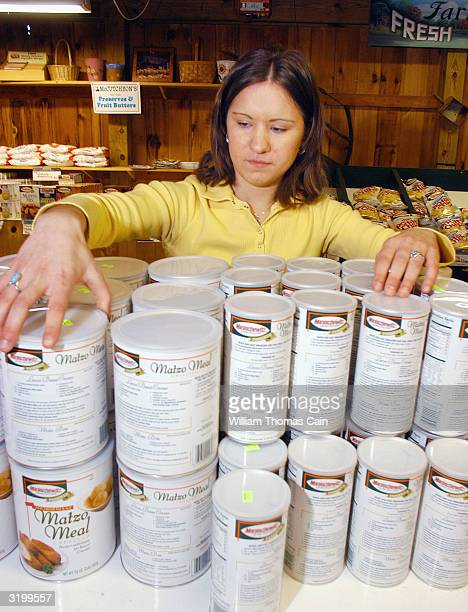 Cashier Emily Holden stocks the shelves at McCaffrey's Passover Store April 2 2004 in Yardley Pennsylvania The family owned McCaffrey's Supermarket...