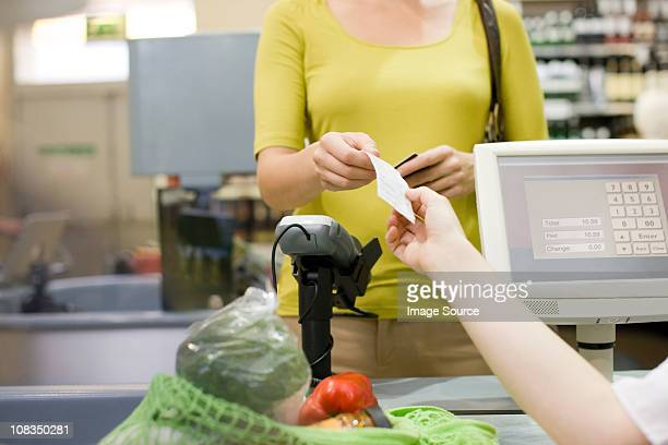 cashier handing receipt to customer - cash register stock pictures, royalty-free photos & images
