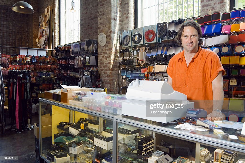 Cashier in music store : Stock Photo