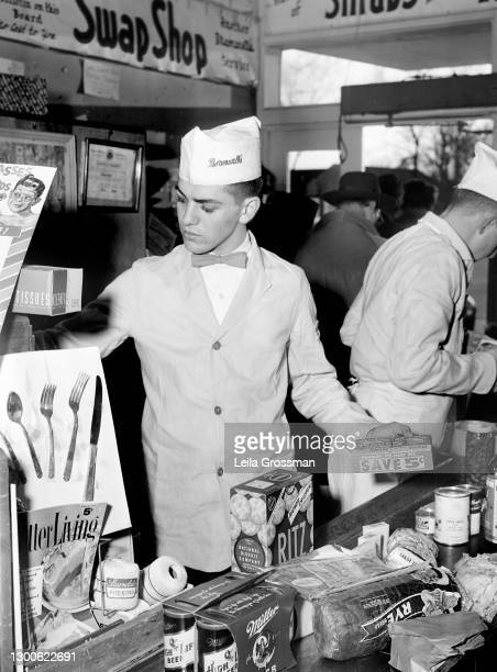 Cashier makes a sale at a swap shop circa 1941 in Nashville, Tennessee.