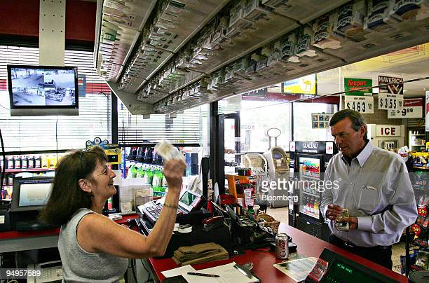 A cashier prepares to sell a pack of Marlboro cigarettes to a customer in Garner North Carolina US on Monday June 15 2009 Altria Group Inc the maker...