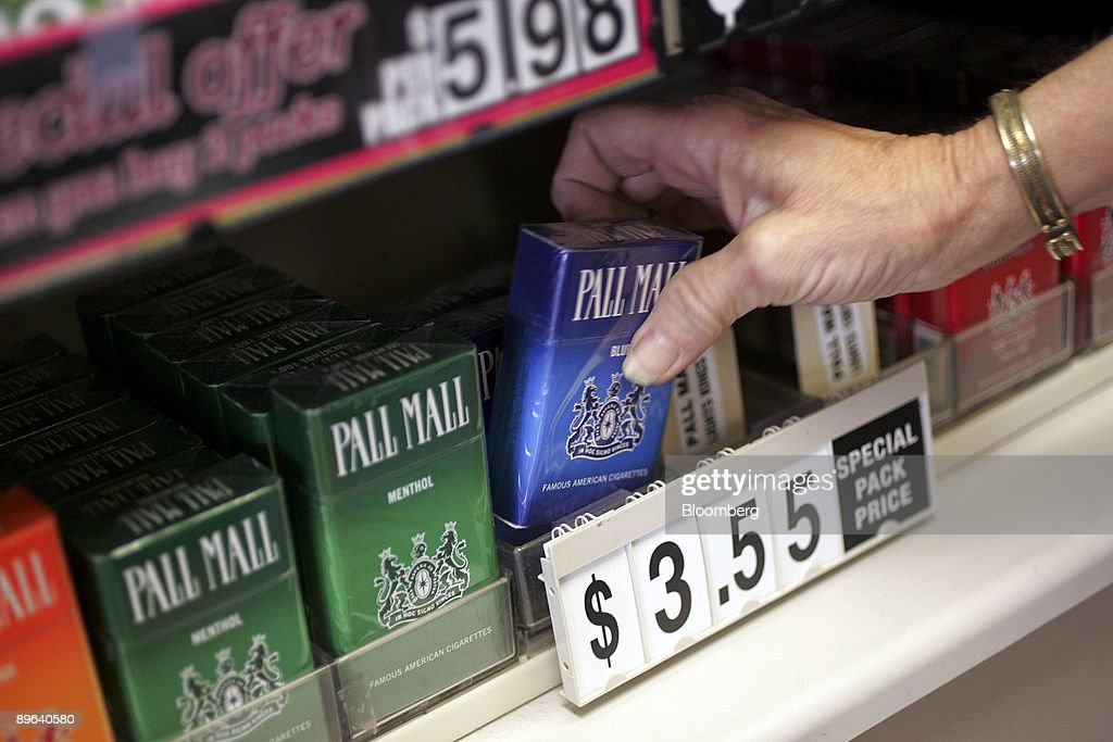 A cashier reaches for a pack of pall mall cigarettes an rj a cashier reaches for a pack of pall mall cigarettes an rj reynolds tobacco co sciox Image collections
