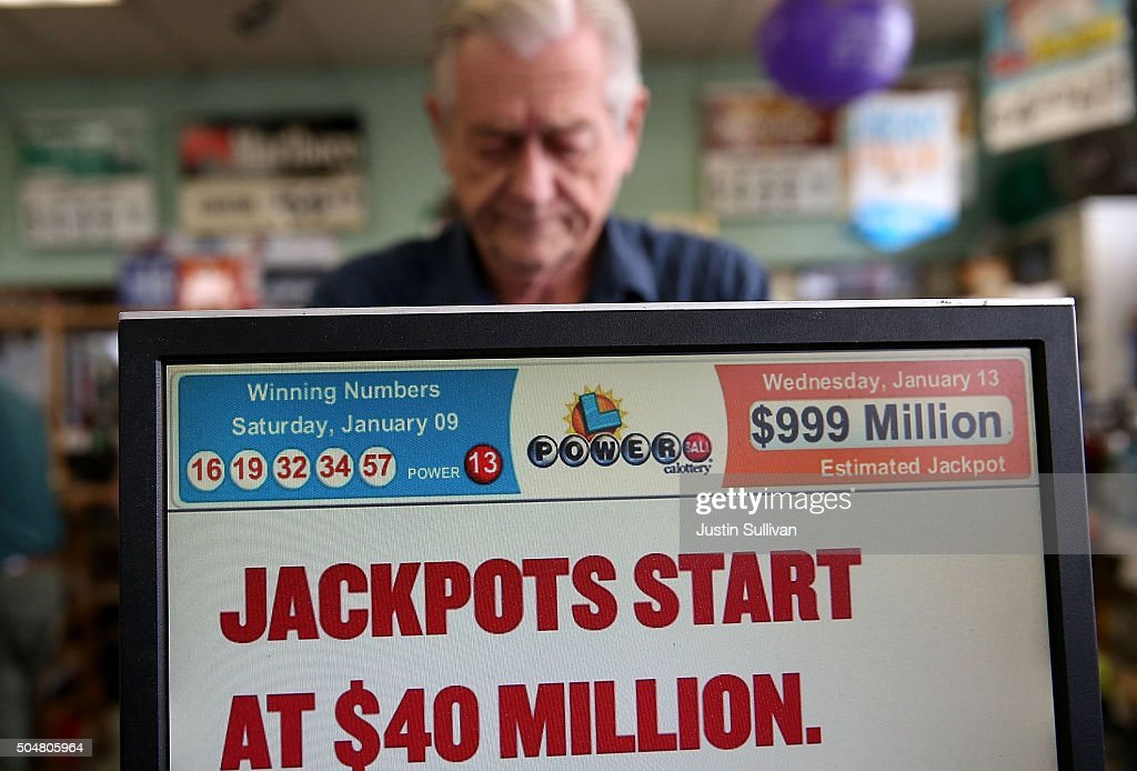A cashier sells Powerball tickets at Kavanagh Liquors on January 13, 2016 in San Lorenzo, California. Dozens of people lined up outside of Kavanagh Liquors, a store that has had several multi-million dollar winners, to -purchase Powerball tickets in hopes of winning the estimated record-breaking $1.5 billion dollar jackpot.