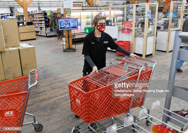 Cashier Tracy Burkert, brings shopping carts back into the store. At Weaver's Ace Hardware on Fleetwood Lyons Road in Richmond Township Monday...