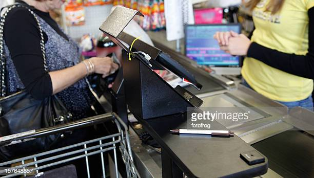 cashier transaction - convenience store counter stock photos and pictures