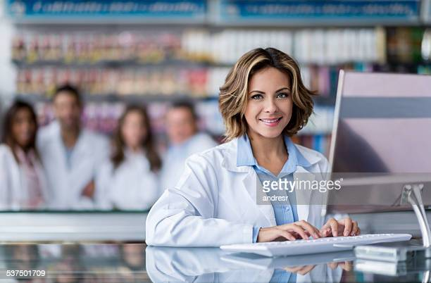 cashier woman at the pharmacy - assistant stock pictures, royalty-free photos & images