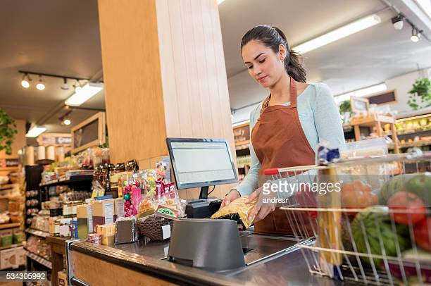 Cashier working at a food market