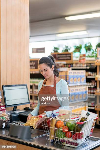 Cashier working at the grocery store