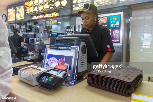 A cashier working behind the counter at McDonalds in Fort Pierce