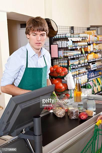 A cashier working in a supermarket