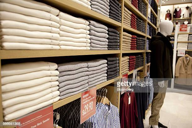 Cashmere clothes are displayed on shelves in a new flagship Uniqlo store operated by Fast Retailing Co in Singapore on Thursday Sept 1 2016 Fast...