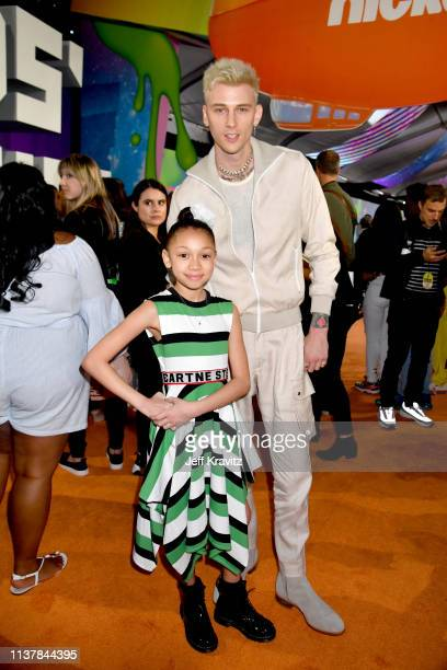 Casie Colson Baker and Machine Gun Kelly attend Nickelodeon's 2019 Kids' Choice Awards at Galen Center on March 23 2019 in Los Angeles California