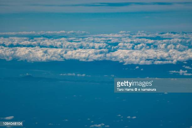 Casiguran town and Baler Bay in Province of Aurora in Philippines daytime aerial view from airplane