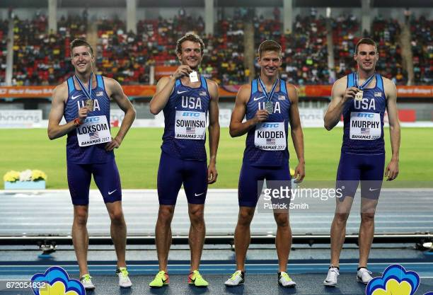 Casimir Loxsom Erik Sowinski Brannon Kidder and Clayton Murphy of the USA celebrate on the podium after placing first in the Men's 4x800 Metres Relay...