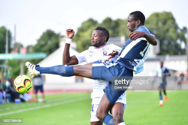 Casimir Ninga of Caen and Samba Camara of Le Havre during the preseason friendly match for the Trophee des Normands between Caen and Le Havre on July...