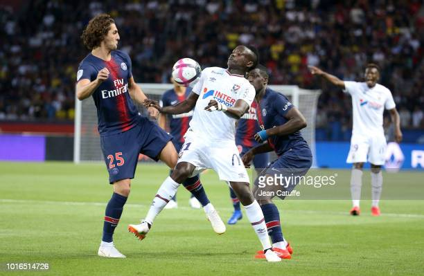 Casimir Ninga of SM Caen between Adrien Rabiot and Moussa Diaby of PSG during the french Ligue 1 match between Paris SaintGermain and Stade Malherbe...