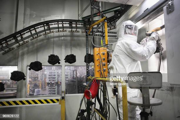 Casings for HarleyDavidson motorcycle engines are powder coated at the company's Powertrain Operations plant on June 1 2018 in Menomonee Falls...