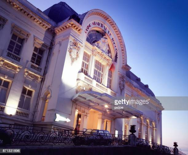 casino barriere in trouville sur mer town, normandy, france at dusk - trouville sur mer stock pictures, royalty-free photos & images