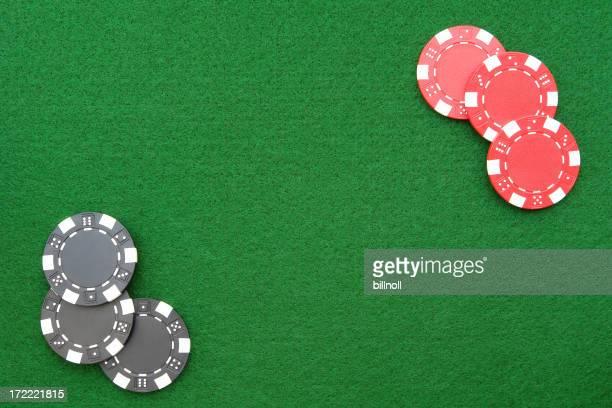 Casino chips on green felt