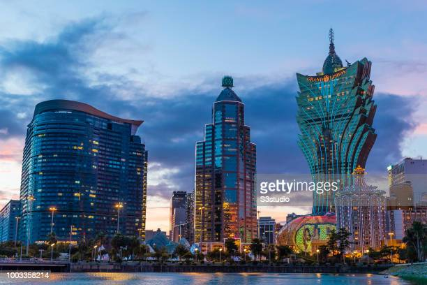 Casino Grand Lisboa operated by SJM Holdings Ltd Banco da China and Torre Lago Panoramico Edf stand illuminated at dusk in Macau Macau on July 18...