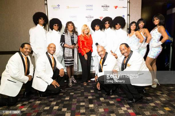Casino Production Show of the Year recipients Motown Extreme Review with The Las Vegas Stars pose for a picture with Casino Entertainment Legend...