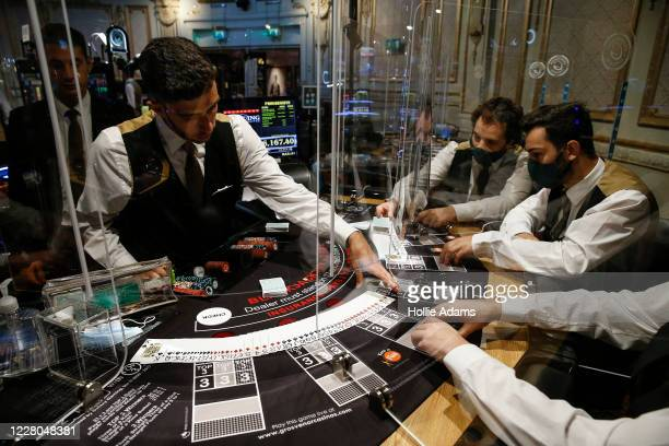 Casino staff play a game of Blackjack at The Rialto casino on August 14, 2020 in London, England. Enhanced safety and cleaning measures are put in...