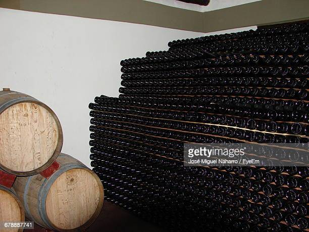 Cask And Wine Bottles In Cellar