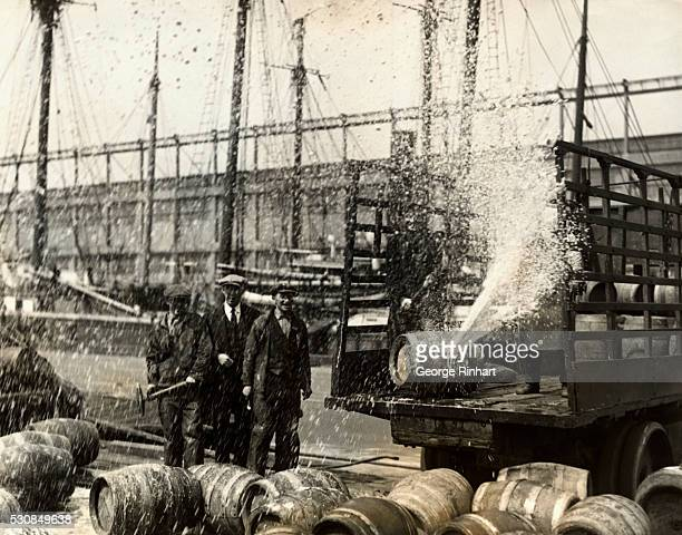 A cask of real prewar beer spouting 4% high in the air after being broached at the US Army warehouse pier in Brooklyn yesterday A million dollars...