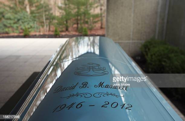 A casket containing the body of Hurricane Sandy victim David Maxwell awaits burial at the Calverton National Cemetery on December 11 2012 near the...