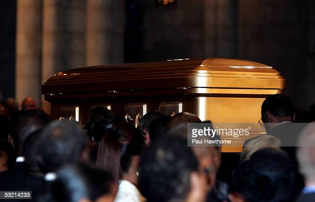 A casket containing the body of Luther Vandross leaves Riverside Church during Vandross' funeral July 8 2005 in New York City