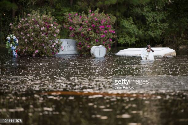 Casket floats in a cemetery inundated by floodwaters from the Waccamaw River caused by Hurricane Florence on September 26, 2018 in Bucksport, South...