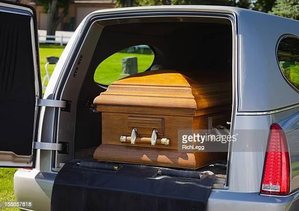 casket in a hearse - hearse stock photos and pictures