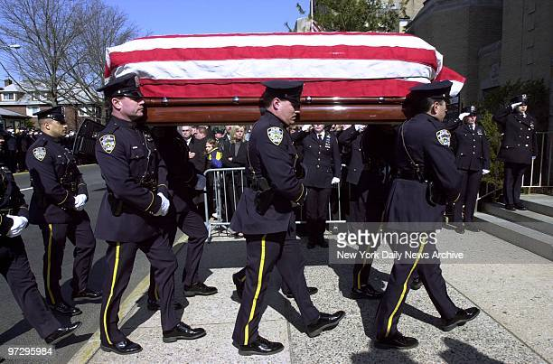 Casket is borne into Our Lady of Lourdes Church in Queens during funeral service for Police Office Moira Smith, who was killed while rescuing people...