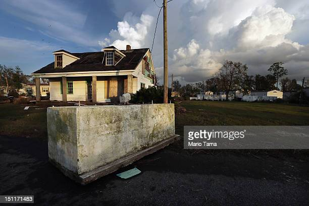 A casket is dislodged from a cemetery and rests in front of a house in Plaquemines Parish following flooding from Hurricane Isaac on September 2 2012...