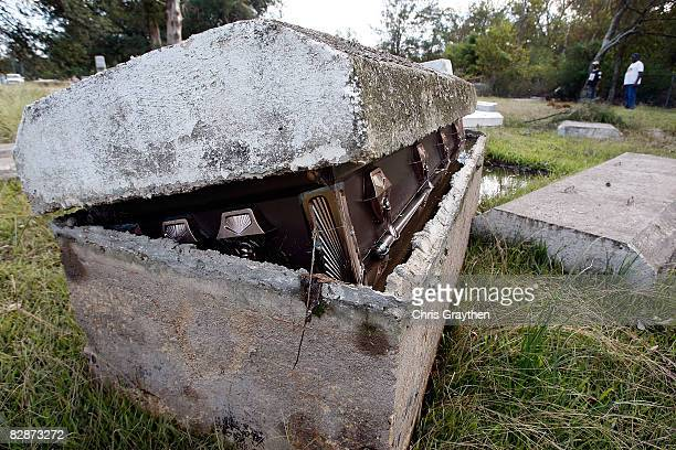 A casket is exposed in its vault as a result of the storm surge associated with Hurricane Ike September 15 2008 in Orange Texas Ike caused extensive...