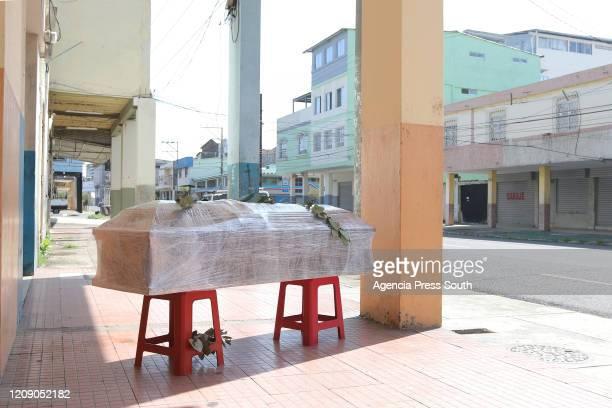 A casket of a coronavirus victim on the street on April 3 2020 in Guayaquil Ecuador According to Johns Hopkins University Ecuador has 3163 confirmed...