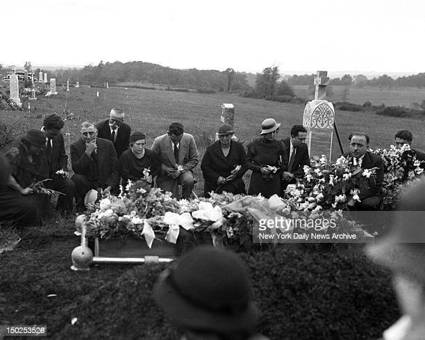 Casket of Mrs Anna Antonio executed at Sing Sing for insurance murder is lowered into grave at Calvary Cemetery as her brother Pasquale Cappello and...