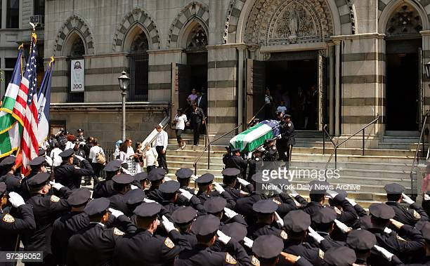 Casket of of Police Officer Alexander Felix is carried into Our Lady of Lourdes Church at 463 west 142nd Street Felix was killed by a drunk driver...