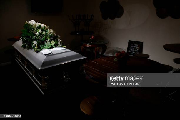 Casket rests in a break room area turned into storage at Boyd Funeral Home due to the surge of Covid-19 deaths on January 14, 2021 in Los Angeles,...