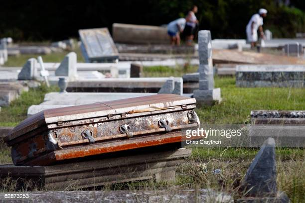 A casket rests on the open ground after floating out of its vault as a result of the storm surge associated with Hurricane Ike September 15 2008 in...