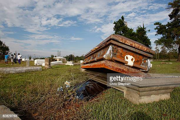 A casket rests on the open ground after floating out of its vault in the storm surge associated with Hurricane Ike September 15 2008 in Orange Texas...