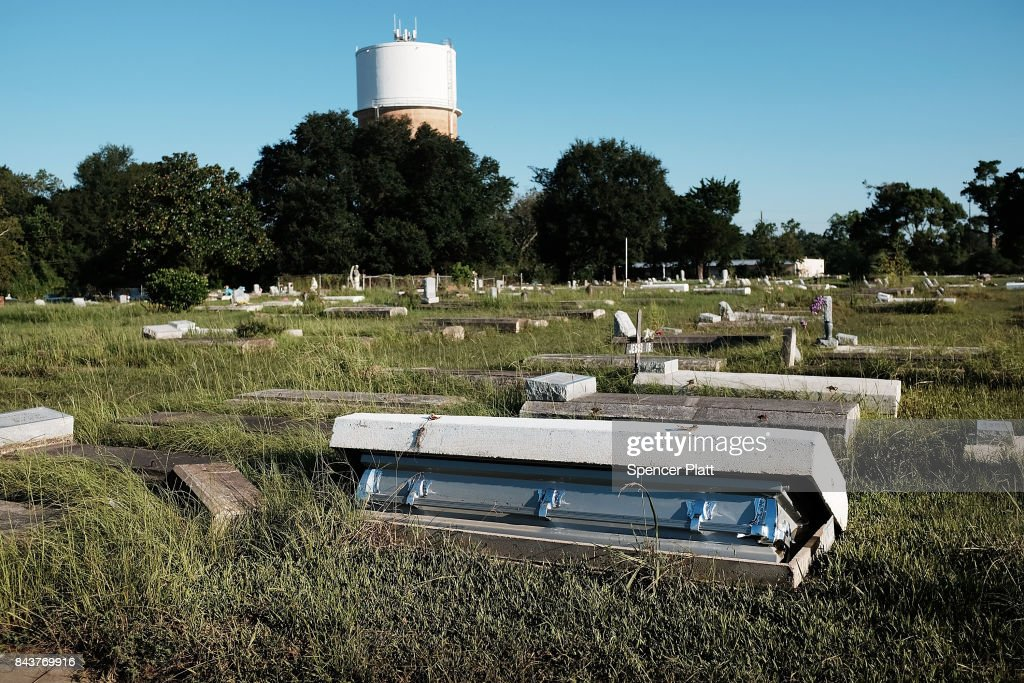 A casket, uprooted by the floods, sits in a cemetery in Orange as Texas slowly moves toward recovery from the devastation of Hurricane Harvey on September 7, 2017 in Orange, Texas. Almost a week after Hurricane Harvey ravaged parts of the state, some neighborhoods still remained flooded and without electricity. While downtown Houston is returning to business, thousands continue to live in shelters, hotels and other accommodations as they contemplate their future.