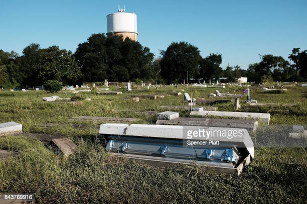 A casket uprooted by the floods sits in a cemetery in Orange as Texas slowly moves toward recovery from the devastation of Hurricane Harvey on...
