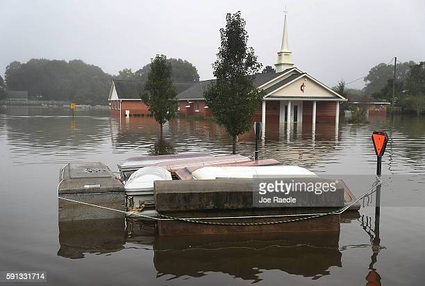 Caskets are seen floating in flood waters near a cemetery on August 17 2016 in Gonzales Louisiana Starting last week Louisiana was overwhelmed with...