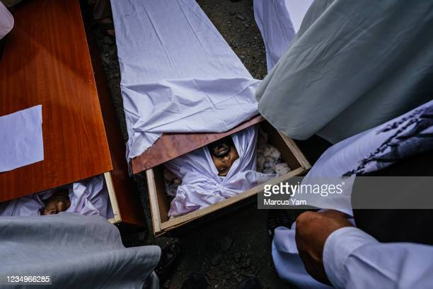 Caskets left open for viewing at the mass funeral for the 10 people the Ahmadi family said were killed in a U.S. Drone strike, in Kabul, Afghanistan,...