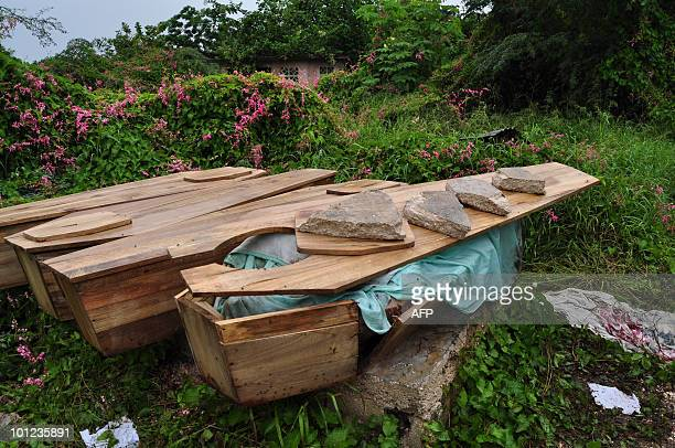 Caskets of victims of the violence in Kingston are left in the May Pen Cemetery of the Jamaican capital on May 28 2010 Jamaican police and soldiers...